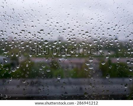 raindrops on window - stock photo