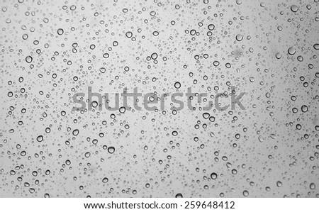 raindrops on window glass, background - stock photo