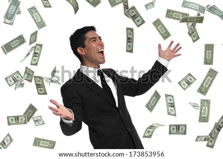 Raining money on a businessman holding his hands out looking to the side