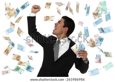 Raining money on an excited businessman. concept - stock photo