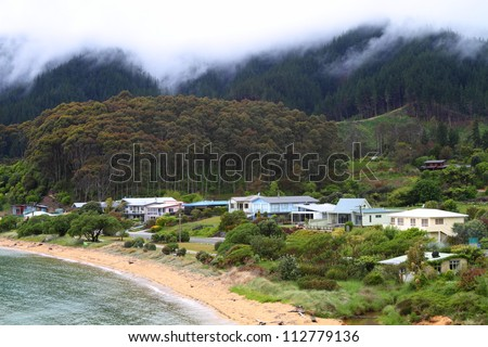 Rainy and clouded morning in New Zealand's small settlement - stock photo