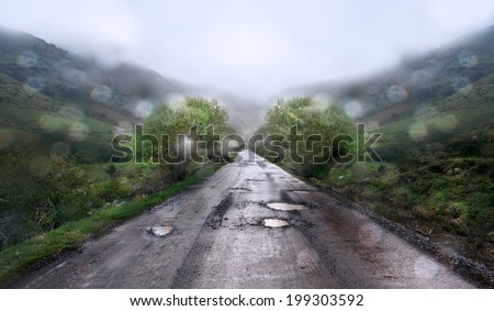Rainy day and mountain road. - stock photo