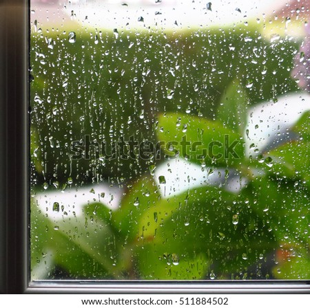Rainy Day. Rain droplets running down the outside of a windowpane.