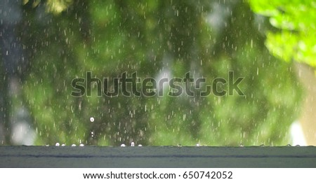 Rainy day, Rain drops on side building natural green background