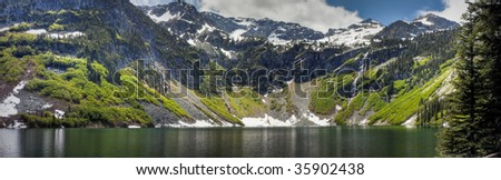 Rainy Lake and waterfalls in the North Cascades - stock photo