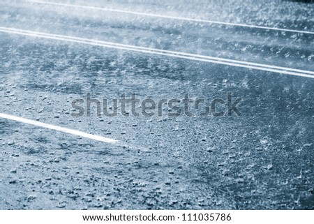 Rainy weather on a city street - stock photo