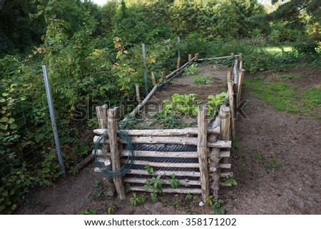 Raised Bed with green plants - stock photo