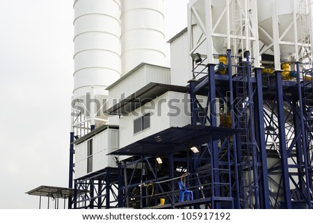 Raised cement construction Factory with Silos attached. - stock photo