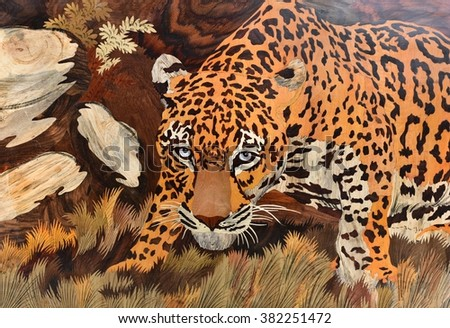Raised crafted aggressive leopard on wood, whole background - stock photo