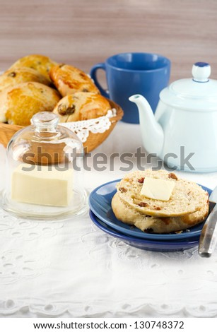 Raisin teacakes served with butter - stock photo