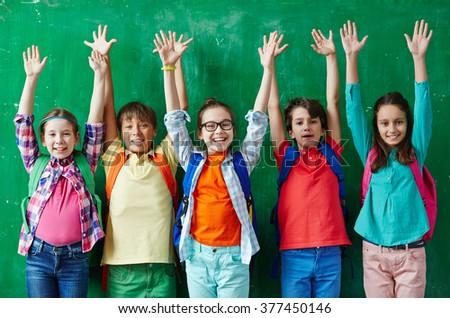 Raising hands - stock photo
