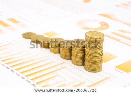 raising stacks of golden coins on yellow business graph, data and report background, concepts of inflation, investment, saving, trading and banking