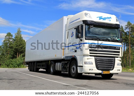 RAISIO, FINLAND - JULY 19, 2014: White DAF XF 105 Semi truck parked. The DAF XF is a range of trucks produced by the Dutch manufacturer DAF since 1997. - stock photo