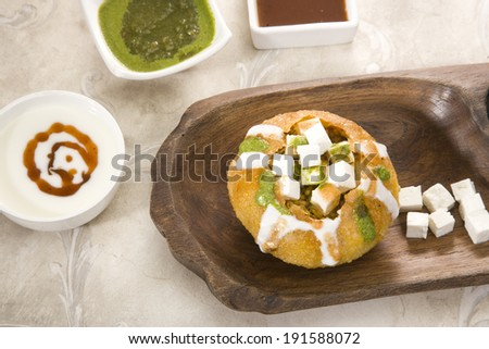 Rajasthani Shahi Raj Kachori stuffed katchori with chees and sprout filling and served with curd - stock photo