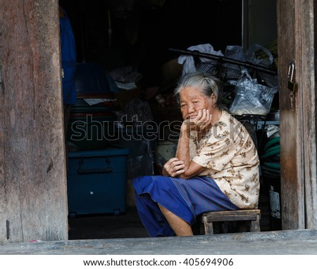 Rajburi, Thailand - April 13, 2016 : The old woman in the  old town. The ancient village tourism of  Rajburi Province.