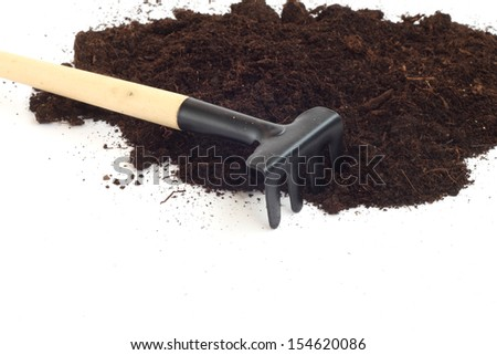 Rake and dirt isolated on white background, gardening concept - stock photo