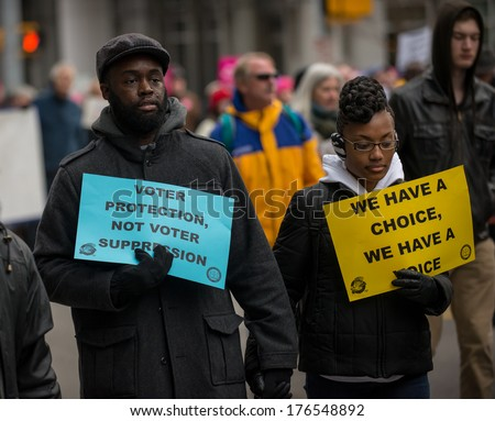RALEIGH - FEBRUARY 8: An estimated 80.000 to 100.000 people crowded the streets of Raleigh for the Moral March, on February 8, 2014 in Raleigh, USA. The demonstration was for a variety of causes. - stock photo