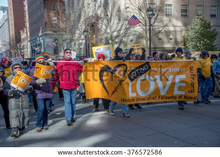 RALEIGH - FEBRUARY 13: Thousands of protesters showed up in downtown Raleigh and braved the cold Saturday as they participated in the 10th Annual Moral March, on February 13, 2016 in Raleigh, USA. . - stock photo