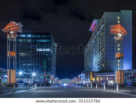 RALEIGH, NORTH CAROLINA-DECEMBER 6, 2015: The downtown area of Raleigh, North Carolina is lit up at night with the Capital Building in the background.