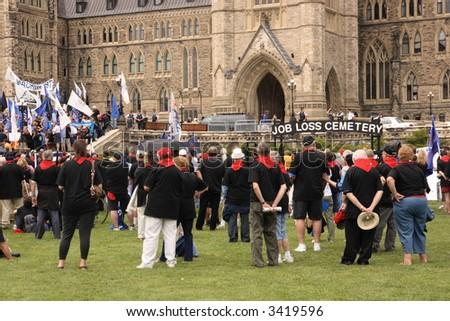 Rally at Parliament Hill over Canadian job losses. Ottawa, Ontario. Canada. - stock photo