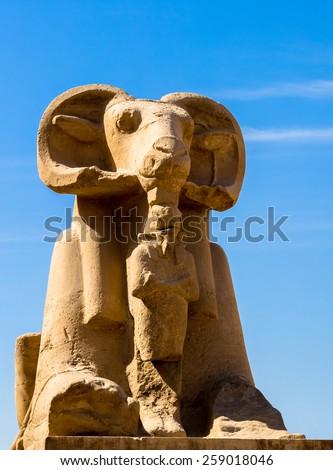 Ram-headed sphinx, symbol of egyptian god Amun, Karnak Temple. Alley of sphinx in Luxor - landmark of Ancient Egypt . - stock photo