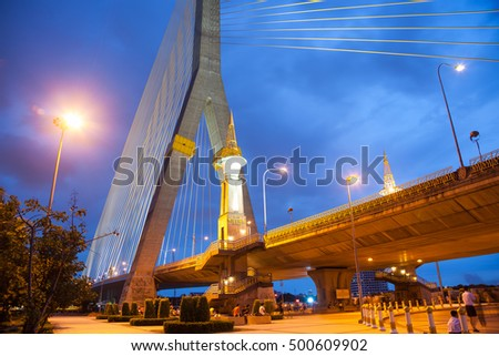 Rama VIII bridge at night.Light from a light pole and a bridge across the river.
