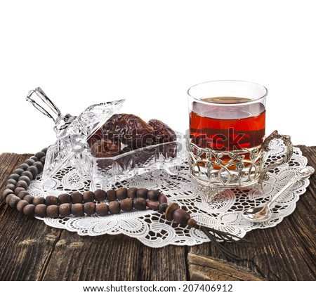Ramadan festival eastern  drink with dates in wooden table isolated on white background - stock photo