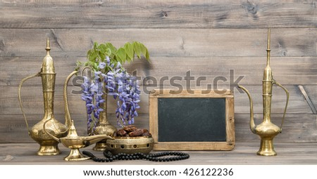Ramadan kareem. Golden oriental decorations and islamic rosary beads.  Chalkboard for your text - stock photo