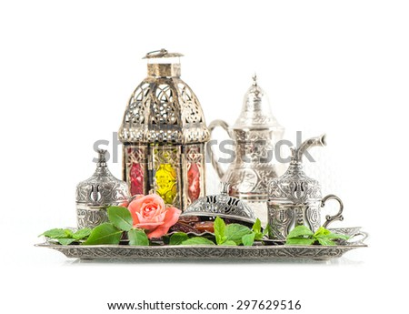 Ramadan kareem. Tea table setting with dates, mint leaves and rose flower. Oriental hospitality concept - stock photo