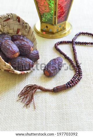 Ramadan lamp, dates and islamic rosary - A symbolic festive objects - stock photo