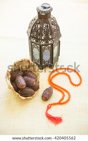 Ramadan lamp with an Islamic prayer beads on wooden background. - stock photo