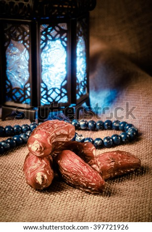 Ramadan lantern, dates and rosary still life. Traditional Egyptian Ramadan lamp with dates. - stock photo