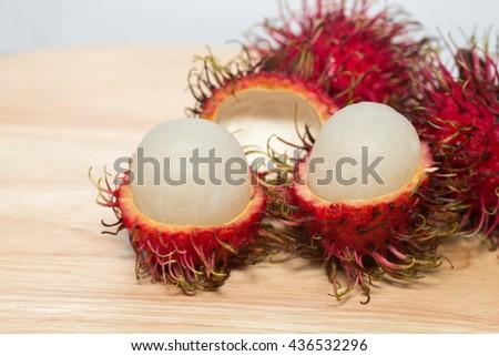 Rambutan fruit inThailand during the rainy season, which has a sweet taste,Rambutan close-up shot,Rambutan on wooden plate,Thai fruit  - stock photo