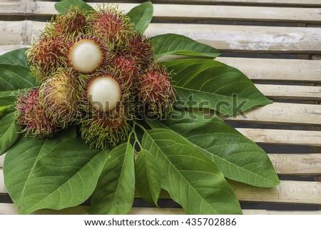 rambutan sweet delicious fruit.background of fresh Thai rambutan on wood background. - stock photo