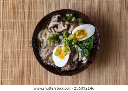 Ramen with pork, green vegetables and egg - stock photo