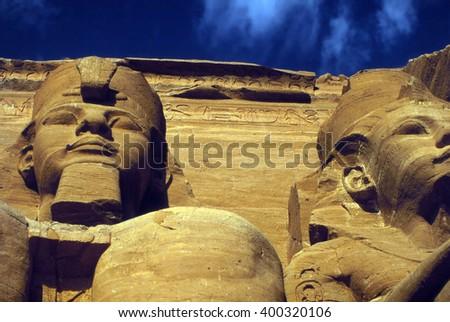Rameses II colossus, seated figure, Egyptian pharaoh,Abu SimbelEgypt, Middle East - stock photo