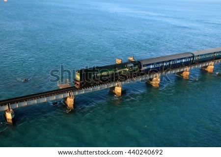 RAMESHWARAM, INDIA - OCT 06: A train pass through the Pamban bridge on October 06, 2013 in Rameshwaram, Tamil Nadu, India. Pamban bridge is the second longest railway bridge in India - stock photo