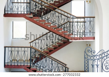 Ramp and staircases that turns inside a building, details of modern urban house - stock photo