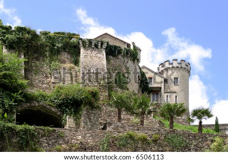 Ramparts - remnants of a medieval fortress in Nontron, Perigord, France, adjusted for living quarters. - stock photo