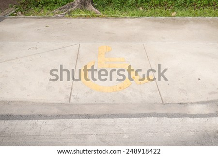 Ramped access, using wheelchair ramp with information sign on floor background. - stock photo