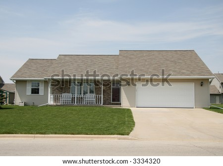 Ranch home with front porch - stock photo