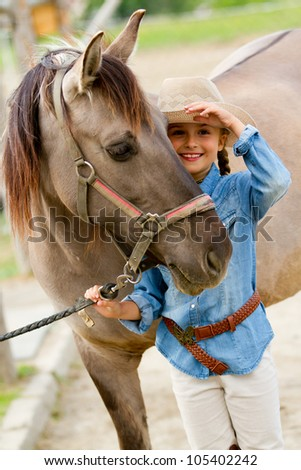 Ranch - Lovely girl with horse on the ranch - stock photo