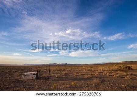 Random brick structure in middle of karoo desert at sunrise - stock photo