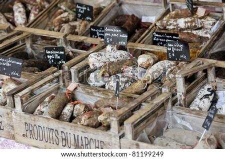 Random French sausages on Provnece market - stock photo