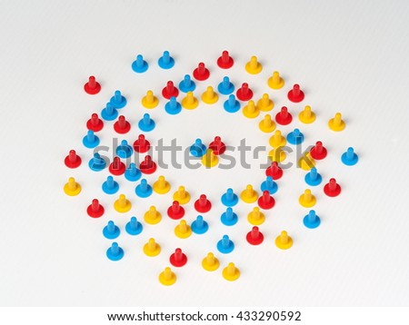 Random group colored plastic hat shaped parts red, blue and yellow on white with three in the center - stock photo