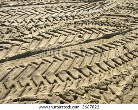 Random multiple tyre tracks in soft sand - stock photo