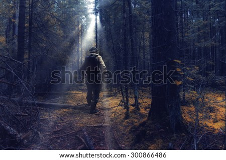 ranger in autumn forest forester guide - stock photo