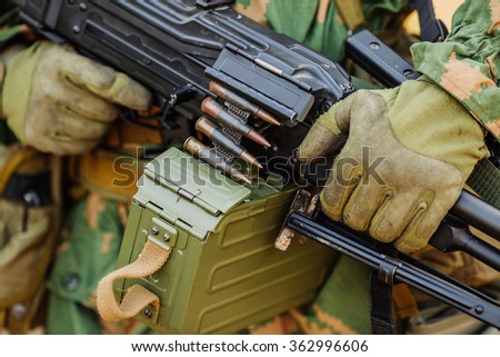 ranger in gloves holding assault automatic rifle - stock photo