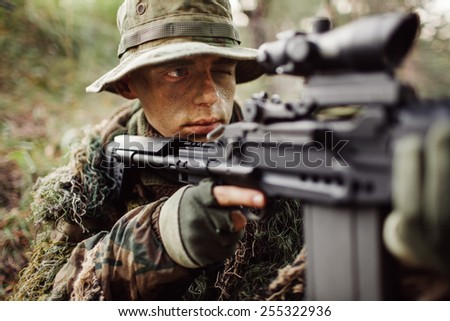 rangers in an ambush aiming at the enemy - stock photo