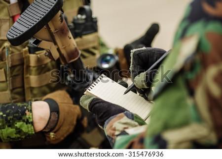 rangers taking notes - stock photo